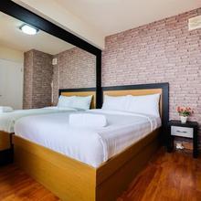 2 Br Bassura City Apartment With Warm Modern Interior Design By Travelio in Jakarta