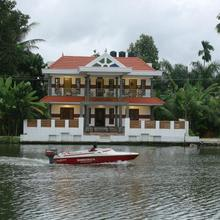 Mango Kerala Homes in Shertallai
