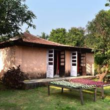 Saffronstays Mango Huts in Nagothane