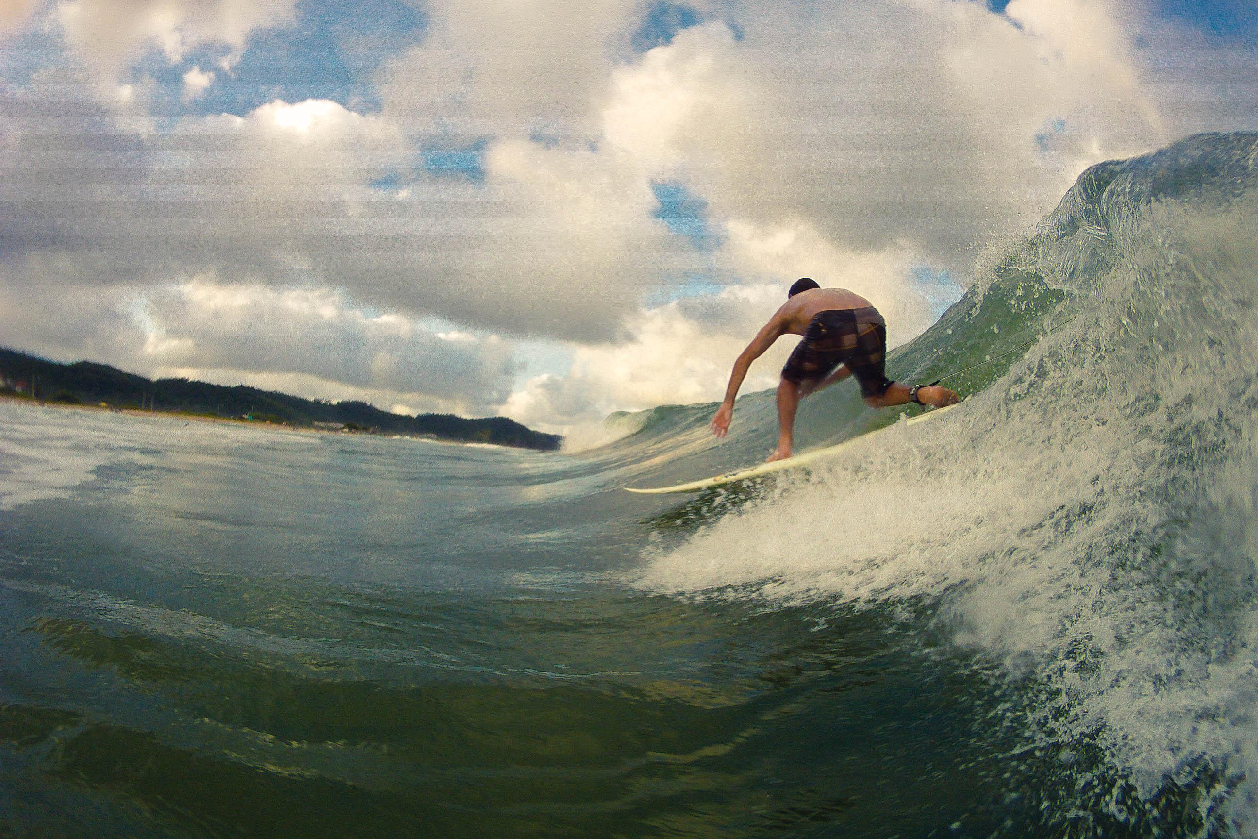 Surfing at Morjim beach